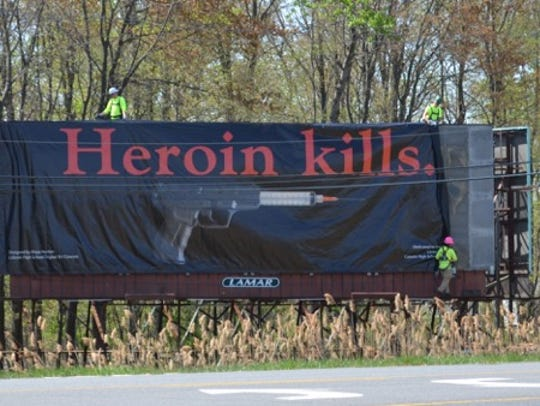 A billboard with the words 'Heroin kills' was designed