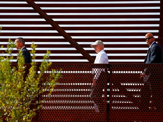 Attorney General Jeff Sessions, center, tours the U.S.-Mexico border with border officials, Tuesday, April 11, 2017, in Nogales, Ariz. Sessions toured the U.S.-Mexico border and unveiled what he described as a new get-tough approach to immigration prosecutions under President Donald Trump.