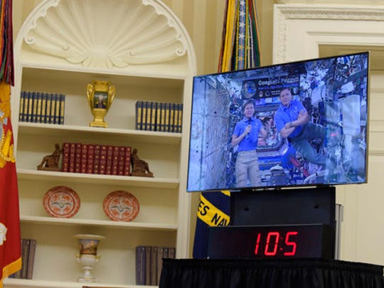NASA astronauts aboard the International Space Station, Commander Peggy Whitson and Jack Fischer talk via video conference with President Donald Trump, Monday, April 24, 2017, in the Oval Office of the White House in Washington.