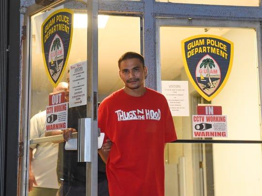 Jeremy Allen Evaristo, 26, of Dededo, is escorted from the Guam Police Department Hagåtña Precinct on June 14, 2017.