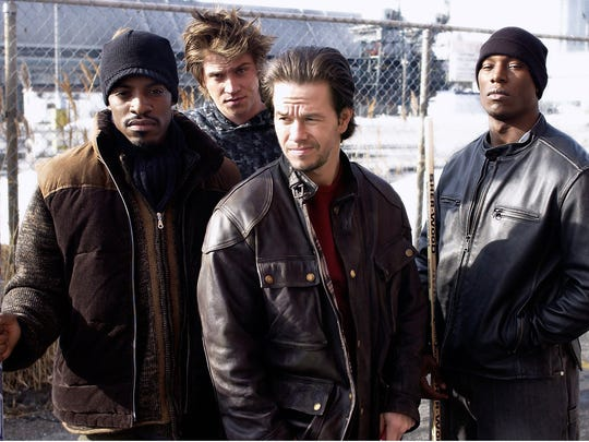 """Andre Benjamin, Garrett Hedlund, Mark Wahlberg and Tyrese Gibson in the movie """"Four Brothers."""""""