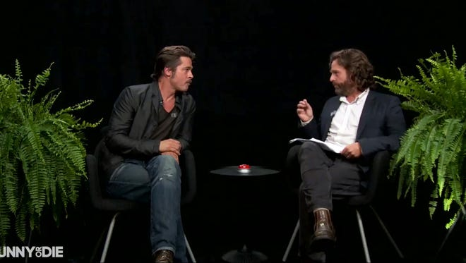 Brad Pitt takes a seat between two potted plants on the latest installment of the Funny or Die series 'Between Two Ferns With Zach Galifianakis.'