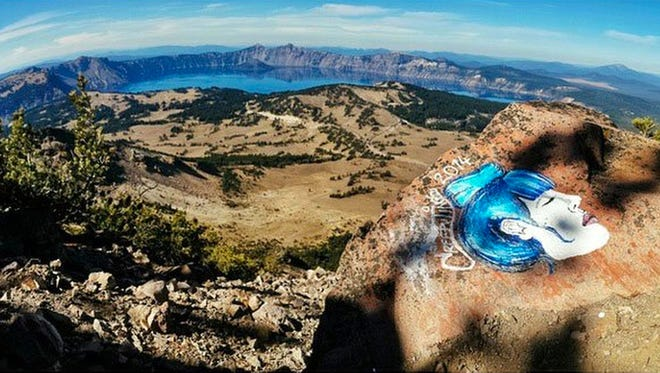 This undated file photo taken from an Instagram posting shows an overlook of Crater Lake in Oregon with a rock painting. Casey Nocket, 23, pleaded guilty Monday of defacing rocks at seven national parks, including Rocky Mountain National Park.