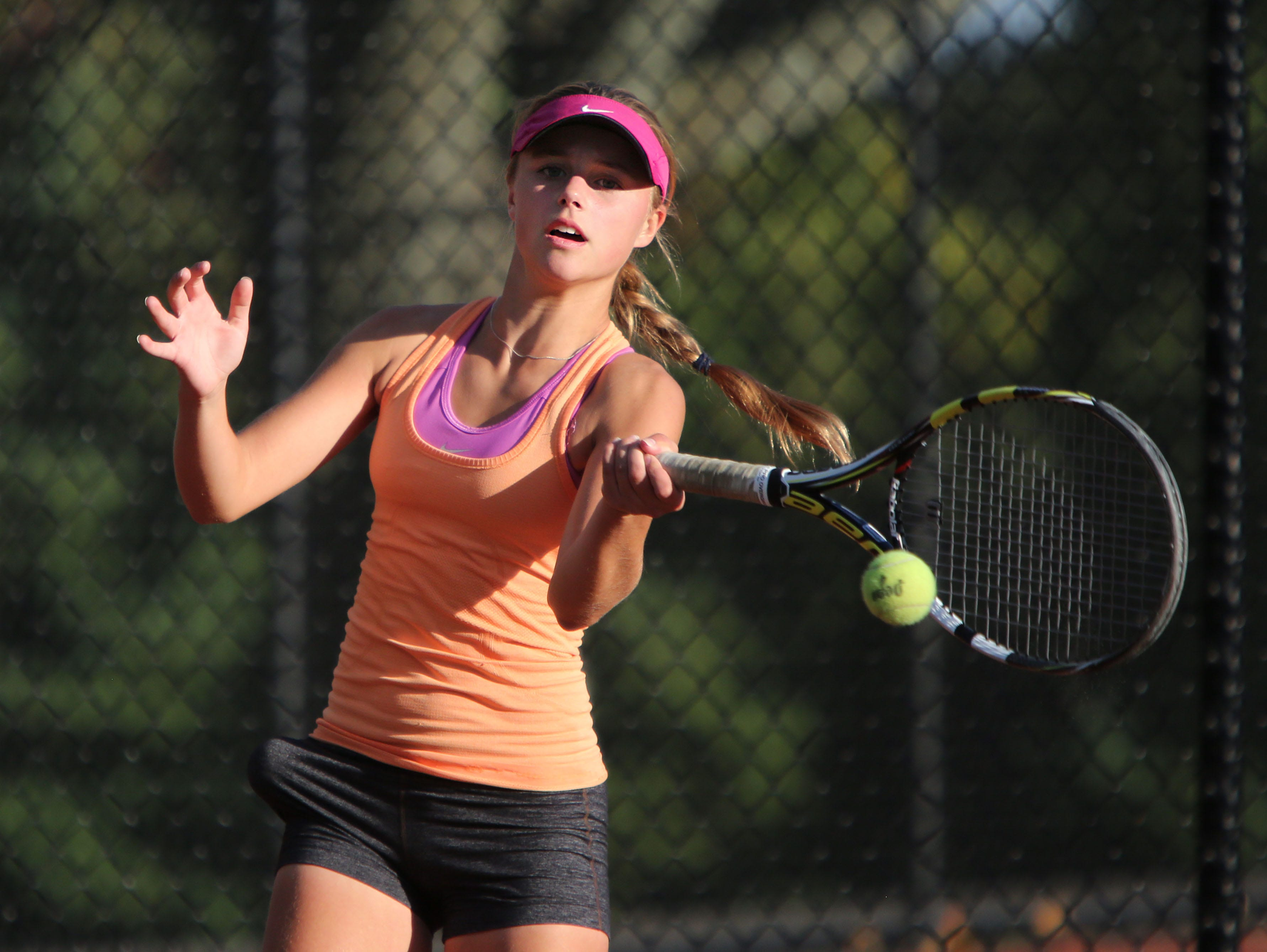 Mamaroneck's Emma Lella returns the ball against Suffern's Sydney Kaplan in the singles finals in the Conference II tennis tournament, Oct. 16, 2015 at White Plains High School. Mamaroneck's Emma Lella went on to win the tournament.