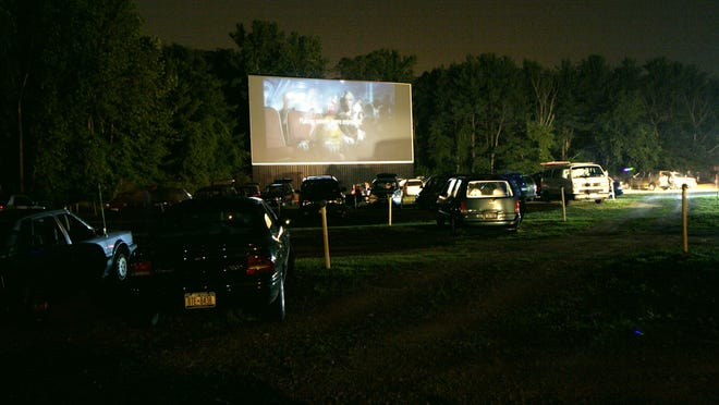 The huge screen of the Overlook Drive-in provides everyone with a good view of the movie in this June 2005 photo.