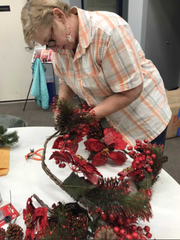 Connie Nehring cuts a decoration apart so that those in her holiday craft decorating class can use its elements for the decorations they create. The class is at Crimson Charities, 6125 W. National Ave., West Allis.