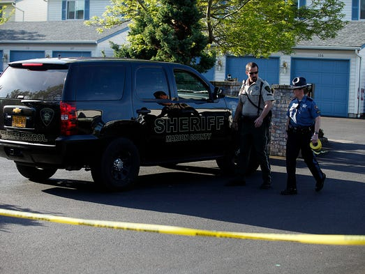 Salem Police and Oregon State Police are on the scene at 4792 Lancaster Drive NE at the Salem Arbor Townhouse Condos, following an officer involved shooting Wednesday, April 30, 2014.