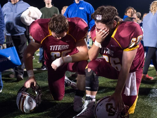 Ryan Sensmeier (65), left, and Grant Holzmeyer (66), kneel after their 26-17 sectional final loss against Memorial at Gibson Southern High School in Fort Branch, Ind., on Friday, Nov. 3, 2017.
