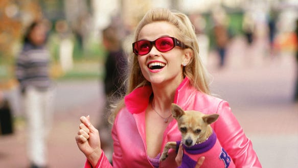 """Reese Witherspoon in """"Legally Blonde"""" proving orange"""