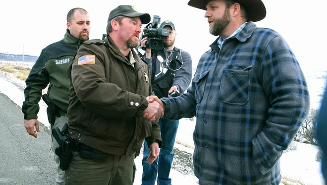 Harney County Sheriff Dave Ward meets with Ammon Bundy at a remote location outside the Malheur National Wildlife Refuge on Thursday, Jan. 7, 2016, near Burns, Ore. Three Oregon sheriffs met Thursday with the leader of an armed group occupying a federal wildlife refuge and asked them to leave, after residents made it clear they wanted them to go home.