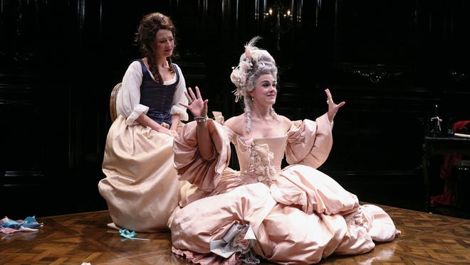 """Deposed queen Marie Antoinette (Jessica Lynn Carroll, right) describes her former life as playwright Olympe de Gouges (Lise Bruneau, left) listens in the Playhouse in the Park's world premiere production of """"The Revolutionists."""""""