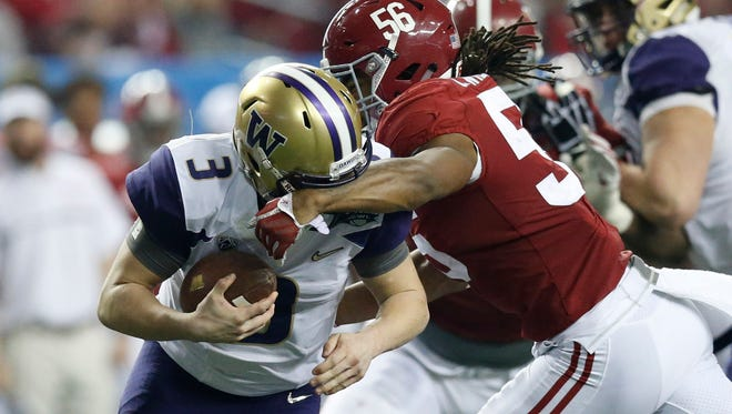 Washington quarterback Jake Browning is tackled by Alabama linebacker Tim Williams during the third quarter of the Peach Bowl.