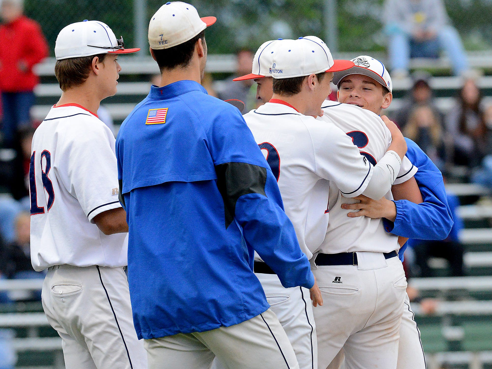 Teammates hug and surround Mason pitcher Harrison Kinney (6) after he struck out Portland's Austin Allison to close out the 3-2 victory in the Diamond Classic matchup Wednesdayat Lansing's Kircher Municipal Park. Allison quieted a Portland seventh-inning rally with the strikeout.