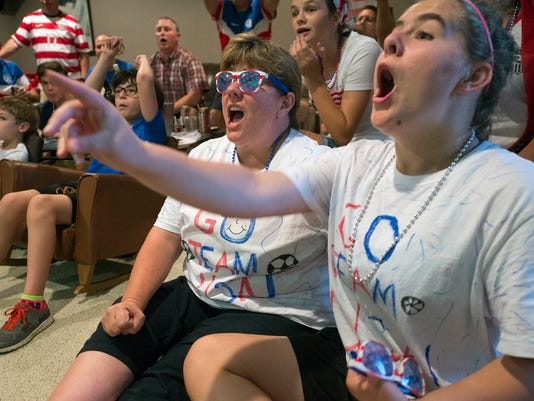 Dorsey Blaine, left, and her daughter Ashley, age 14,  watch the Women's World Cup soccer final in Lower Windsor Township Sunday July 5, 2015. The pair recently traveled to Montreal twice to watch games leading up to the game tonight. Paul Kuehnel - York Daily Record/ Sunday News