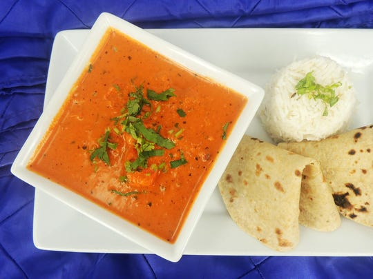 Chicken makhani, marinated chicken cooked in a tomato-based gravy, is one dish from Chutney Chefs served with Jeera rice and rotis.