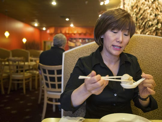 Bamboo House co-owner Shuwa Chen demonstrates how to eat soup dumplings. A reader wants to know where to go now that the Newark restaurant has closed.