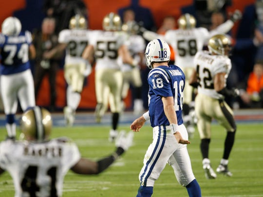 Indianapolis Colts quarterback Peyton Manning looks on as Saint Tracy Porter runs into the end zone with a touchdown after a fourth quarter interception in the Super Bowl in Miami Sunday, Feb. 7, 2010. (Sam Riche / The Star)
