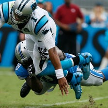 Lions defensive tackle C.J. Mosley brings down Carolina Panthers quarterback Cam Newton for one of his two sacks Sunday. Mosley led the way as the defensive line went to the head of the class in the report card for this loss.
