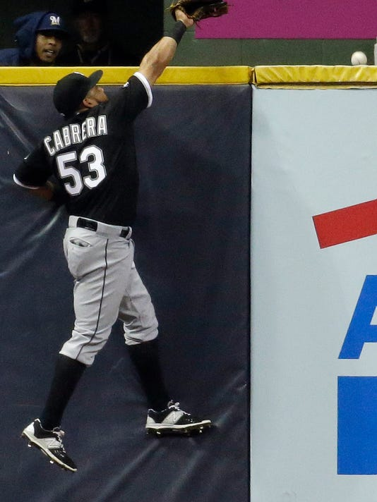 Chicago White Sox's Melky Cabrera can't catch a home run hit by Milwaukee Brewers' Elian Herrera during the fifth inning of a baseball game Tuesday, May 12, 2015, in Milwaukee. (AP Photo/Morry Gash)