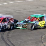 Matt Hirschman leads Brian Defebo through Turn 4 in the ROC Modified race at Chemung Speedrome in 2013.