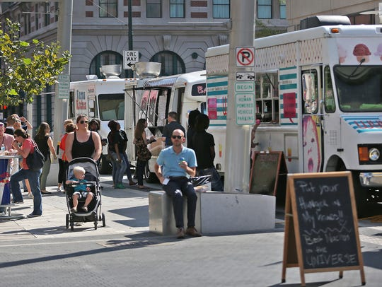 People enjoy lunch on Georgia St., Friday, September