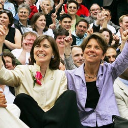 In this May 17, 2005, file photo, Julie, front left, and Hillary Goodridge pose with other gay couples and supporters as they celebrate their first wedding anniversary in Boston. The couple, who led the legal fight for Massachusetts to become the first state to legalize same-sex marriages, filed for divorce Thursday, Jan. 29, 2009.