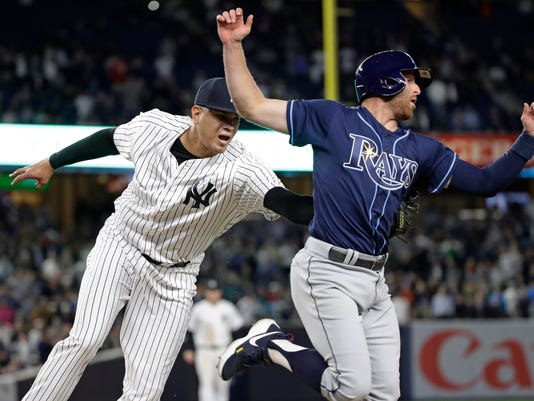 New York Yankees relief pitcher Dellin Betances tags out Tampa Bay Rays' Brad Miller during the eighth inning of a baseball game Thursday, April 13, 2017, in New York. (AP Photo/Frank Franklin II)