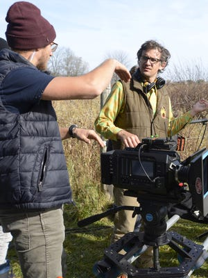 """""""Depth of Field"""" Director Tate Bunker talks with crew members during filming of """"Depth of Field."""""""