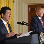 Donald Trump doesn't challenge Japan on currency in meeting with Abe