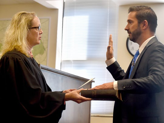 District Judge Jennifer Clancy, left, swears in Shawn Mauck as the new mayor of West York in her Spring Garden Township courtroom on Friday.