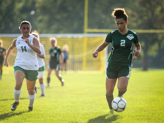 Fairfield's Annabel Anderson (2) heads upfield with York Catholic's  Anabella Ebel (14) in pursuit in the second half of a 15-0 win over York Catholic on Thursday.