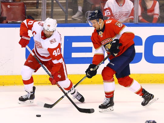 Detroit Red Wings left wing Henrik Zetterberg (40) and Florida Panthers defenseman Alex Petrovic (6) battle for the puck in the first period at BB&T Center, Saturday, Feb. 18, 2018.