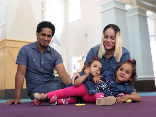 Ballenie, left, and Bellanie Camacho play with parents,