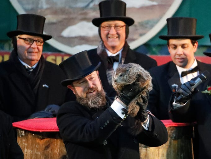 Groundhog Club co-handler Al Dereume holds Punxsutawney