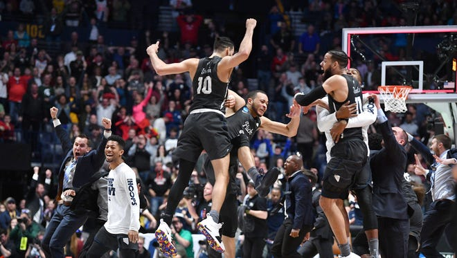 Nevada celebrates its last-second win over Cincinnati in their second-round game in the NCAA Division I Men's Basketball Championship at Bridgestone Arena Sunday, March 18, 2018 in Nashville, Tenn.