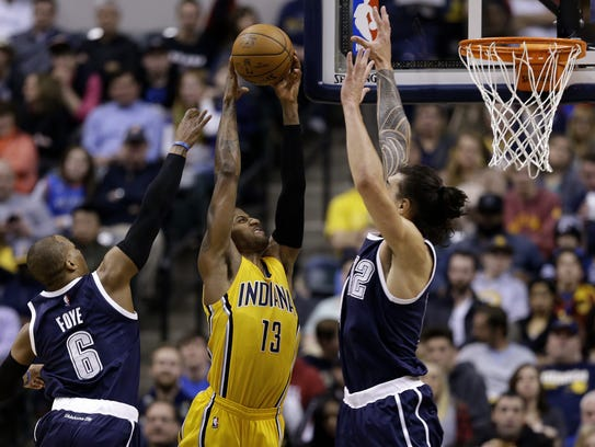 Indiana Pacers forward Paul George (13) goes up for