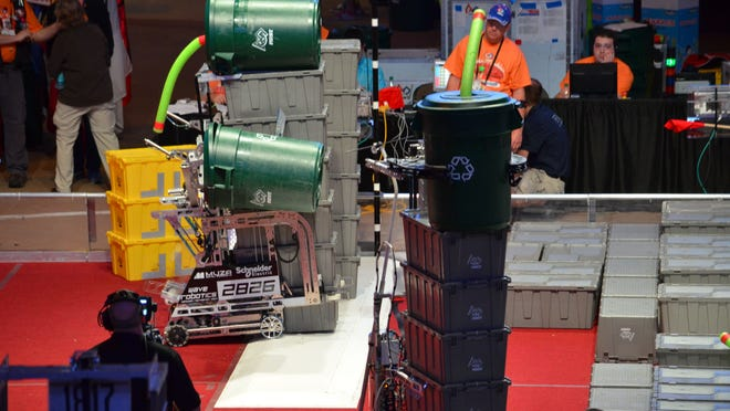 The Wave Robotics team's robot, Depthcharge, transports totes during a match at the FIRST Tech Challenge World Championship competition at the Edward Jones Dome in St. Louis.