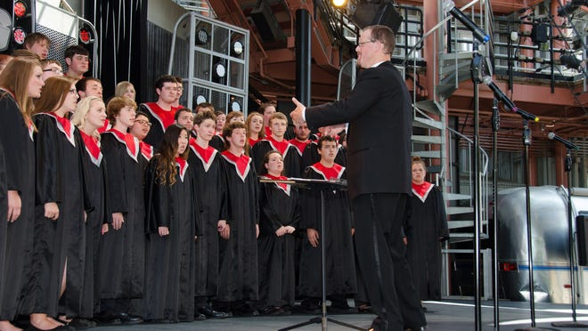 Brett DeYoung directs the South Albany High School Rebel Singers at Disneyland last May. The ensemble qualified for the 2015 OSAA Choir State Championship after a fire destroyed the choir room on April 1.