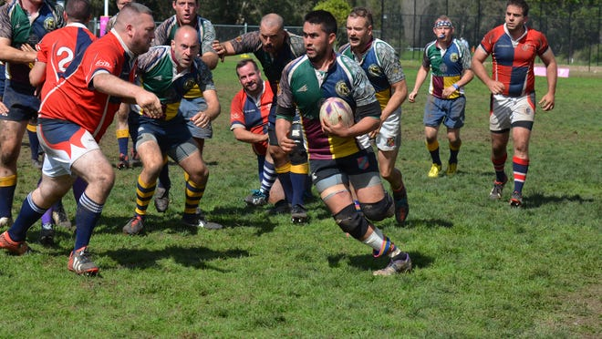 Sky Lee of the Nashville Grizzlies carries the ball in a game played in the 2014 Bingham Cup in Sydney, Australia.