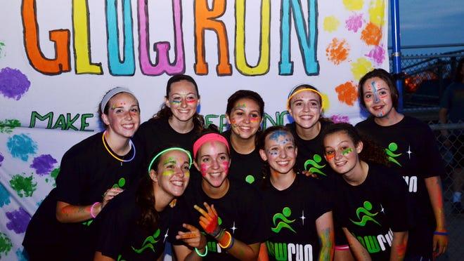 Seneca High School's Psychology Club hosted its Glow Run on May 29 to raise awareness of mental illness.