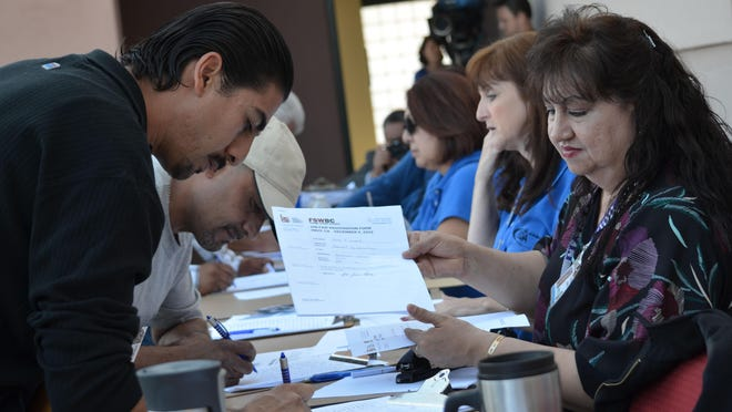 Nearly 600 people lined up at the county's Workforce Development Center in Indio in December 2012 to meet with Canadian employers recruiting carpenters, welders and other construction trades workers for jobs up north.