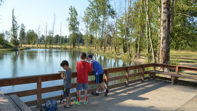 Brothers Christian, 6, Tyler, 11, and Collin, 11, of Gresham try their luck at Pond 6 at St. Louis Ponds and had it all to themselves.