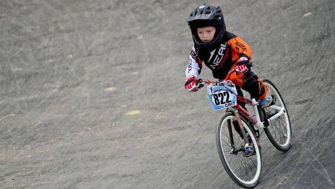 Jeremy Plowman, of Clarkston, races during a BMX event at Goodells County Park Sunday