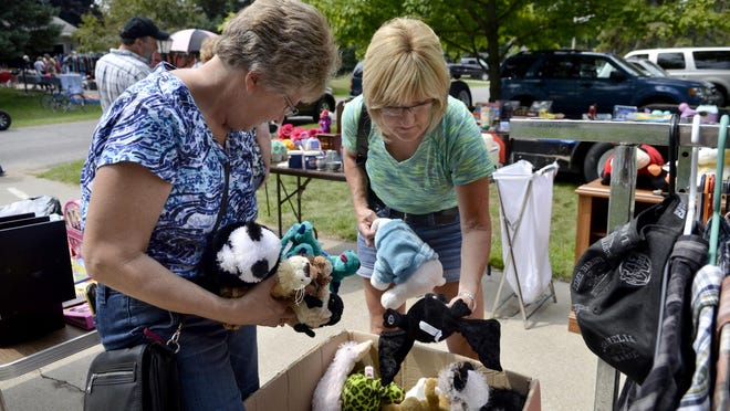 Denise Junga and Debbie Filbeck, both of Croswell, look through a bin of stuffed animals during the 2014 Yard Sale Trail.