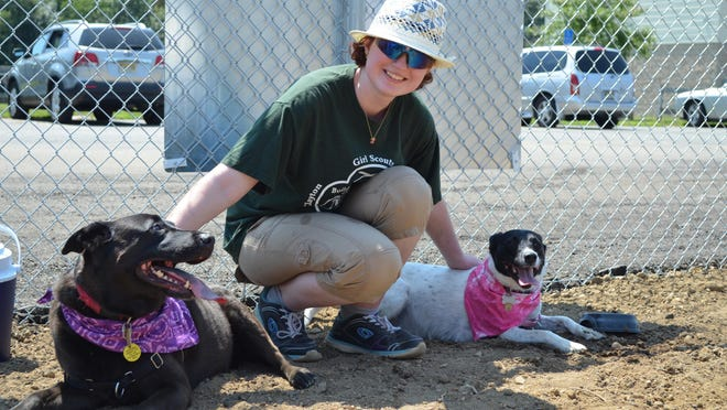 Elizabeth Culver, 18, of Clayton is pictured with her dogs, Eagle and Phoenix, at the Clayton Dog and Butterfly Dog Park located inside the Autumn Pasquale Memorial Park on East Avenue in Clayton.