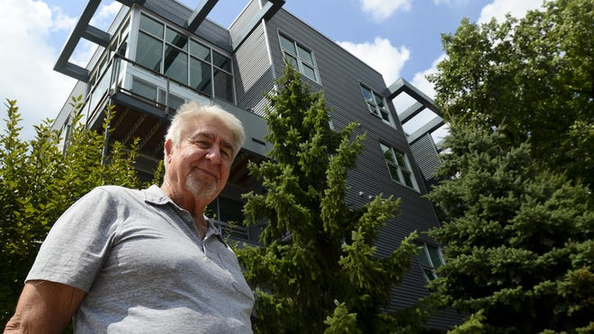 Robert Wolfson stands outside of the first loft complex he built in Royal Oak, Troy Street Lofts, at 614 S. Troy St., in August.