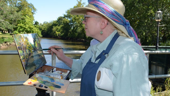 Jeanne Bruneau of Media, Penn., creates an oil painting for the Cohansey River Plein-Air Competition during Cohansey Riverfest in Bridgeton on Saturday. Photo/Jodi Streahle
