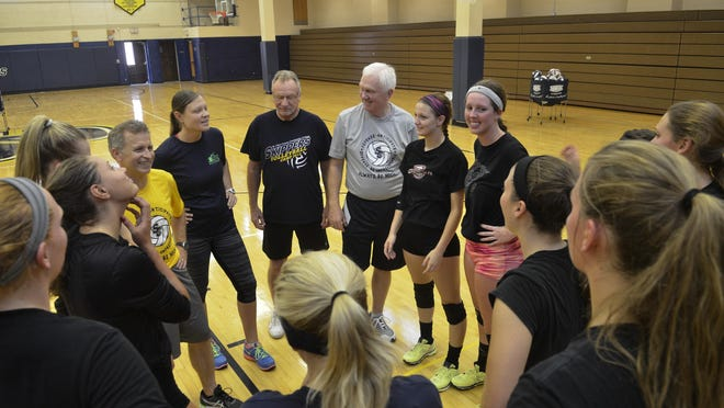 St. Clair County Community College volleyball coaches talk with their players Tuesday night before their volleyball practice at St. Clair County Community College.
