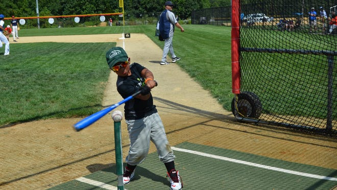Devin Ramos, 7, of Vineland practices hitting at the Teens That Transcend baseball clinic on Saturday. Photo/Jodi Streahle