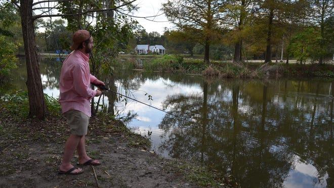 Local fisherman Justin Gossett fishing in the Bayou Vermilion District's retention pond on Nov. 10.